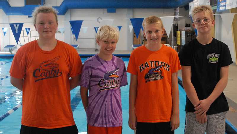 PMG PHOTO: DEREK WILEY - Canby Gators Jamison Chard, Ethan Beck, Isaac Beck and Whyley Pierce competed in the Oregon Swimming 11-and-over championships July 25-28 at Mt. Hood Community College in Gresham.