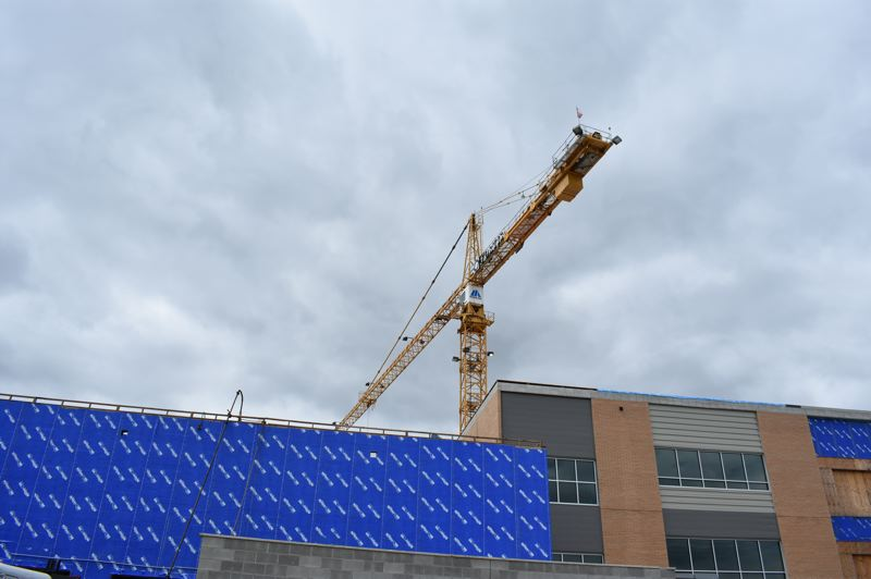 PMG PHOTO: TERESA CARSON - This is the big tower crane looming over the Gresham High School. It was needed because of the tight quarters for the first phase of construction at Gresham High School.