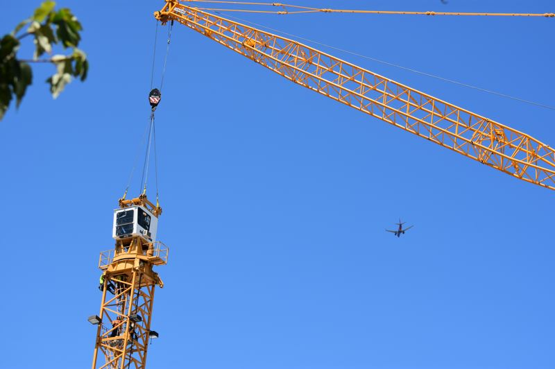 PMG PHOTO: TERESA CARSON - The operators cab is moving off what remains of the tower crane.