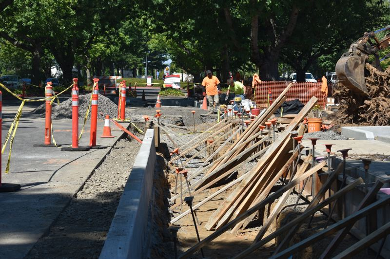 PMG PHOTO: TERESA CARSON - Workers carve out raingardens and swales in an earlier phase of construction on Mt. Hood Community College parking lots. The last phase will start Monday, Aug. 5.