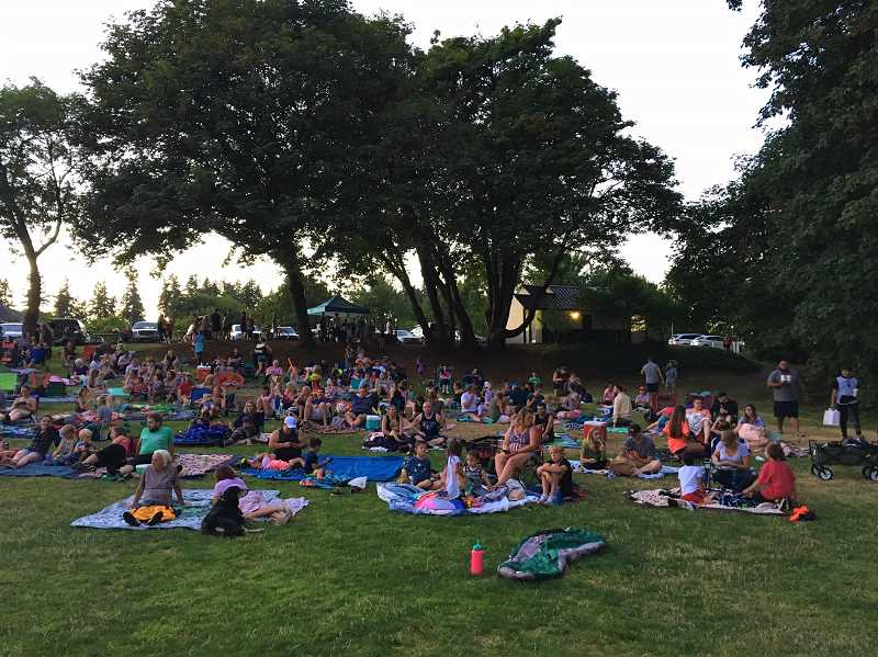 COURTESY PHOTO - An estimated 300 community members flock to watch the outdoor movies in Wilsonville.