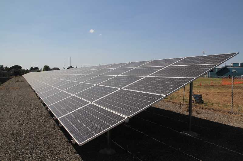 PMG PHOTO: JUSTIN MUCH - The array of solar panels is a key element to Success Alternative High Schools Net-Zero rating.