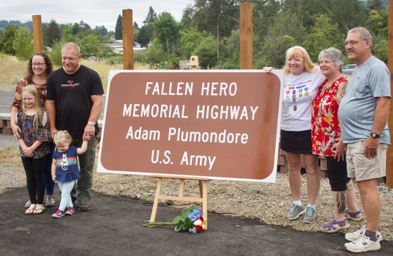 PMG PHOTO: CHRISTOPHER KEIZUR - A sign honoring Adam Plumondore was placed at the intersection of the Mt. Hood Highway and Southeast Palmquist Road.