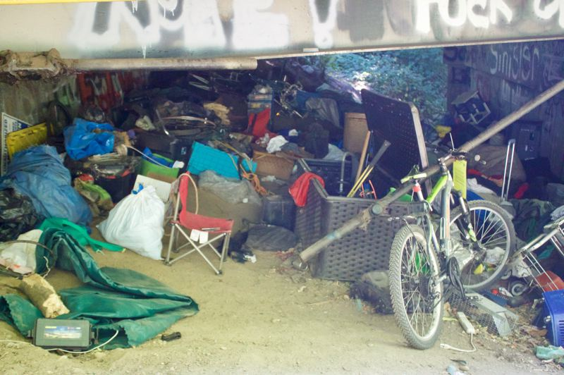 PMG PHOTO: CHRISTOPHER KEIZUR - Fifty feet from the Gresham portion of the trail, homeless in Portland are still accumulating thousands of pounds of trash along the Springwater Corridor Trail.