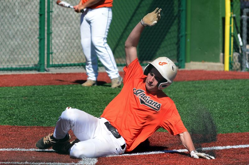 PMG PHOTO: DAVID BALL - Jake Bernhard of Scappoose slides into home safely during a five-run third inning in the Indians OIBA playoff game against Sandy.