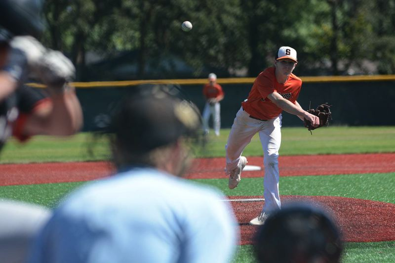 PMG PHOTO: DAVID BALL - Scappoose starting pitcher Thomas Greiner follows an offering to the plate as the Indians battle Sandy at Putnam.