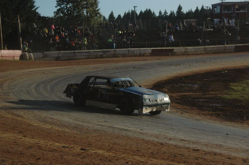 COURTESY PHOTO: MIKE WEBER - Gary Kordosky of Scappoose competes in the July 27 Sportsman main event in his Chevrolet Monte Carlo at River City Speedway in St. Helens.