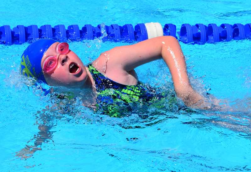 PHOTO COURTESY OF CASSEY DICKEY - Ilsa Ptomey swims in a meet earlier this year. Ptomey helped her team to second place in the 10U 100 freestyle relay at the district meet. Ptomey swam with Ariel Wilber, Madison Railey and Madilyn Bell. Prineville's other relay team of Paige Wood, Gretchen Fewell, Mia Levesque and Lilly Lane won the race.