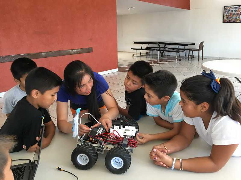 COURTESY PHOTO - Aliris Tang has experience volunteering and organizing events. Here, Tang is leading a robotics program at an orphanage in Mexico.