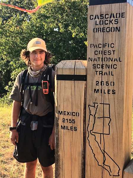 PHOTO COURTESTY OF SHILOH BINDER - Shiloh Binder stands at the trail marker of the Bridge of the Gods, the northernmost point of the Pacific Crest Trail in Oregon.