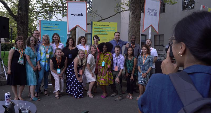COURTESY: BBPDX/CLINTON HERRICK - Members of the Business for a Better Portland board at the alternative chamber of commerce's summer social in Oregon Square near Lloyd Center. Fourth from left is Ashley Henry, fifth from left and standing is Jenn Lynch of the Portland Seed Fund.