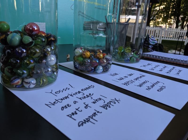 PMG; JOSEPH GALLIVAN - Attendees were asked to vote with marbles to show their awareness of what BBPDX does.