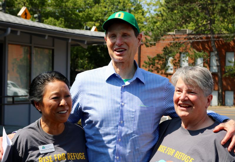 PMG PHOTO: ZANE SPARLING - Sen. Ron Wyden, D-Oregon, poses for a photo with Multnomah County Commissioner Lori Stegmann, left, and Rep. Carla Piluso, D-Gresham, on Saturday, Aug. 3.