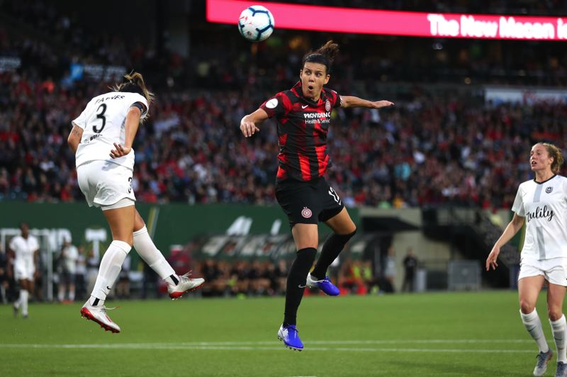 PMG PHOTO: JAIME VALDEZ - Christine Sinclair of the Portland Thorns heads a shot toward the goal in a July game against Reign FC at Providence Park.
