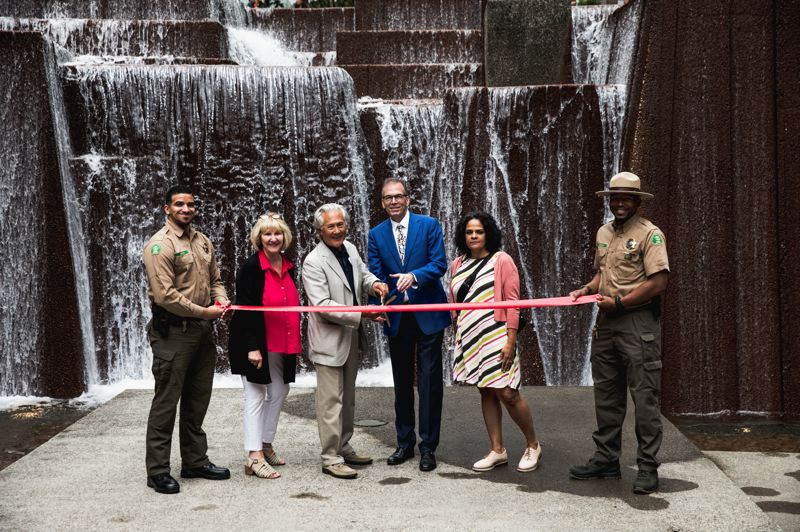 COURTESY PARKS & REC - FROM LEFT: Park Ranger Rhonan Eshoo, Halprin Landscape Conservancy Executive Director Karen Whitman, HLC board president Bob Naito, Commissioner Nick Fish, Parks Director Adena Long and Park Ranger Vicente Harrison cut the ribbon at Keller Fountain on Tuesday, July 30.