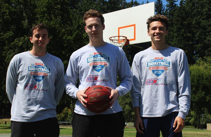 PMG PHOTO: DEREK WILEY - Tanner Karp, left, Tyler Hieb and Harrison Steiger, all Wilsonville grads, were part of Oregon Tech's run to the NAIA men's basketball national championship game.