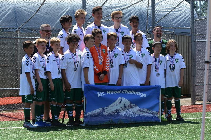 PMG PHOTO: DAVID BALL - The Thelo Predators 14U squad shows off its second-place medals from last weekends Mt. Hood Classic tournament.