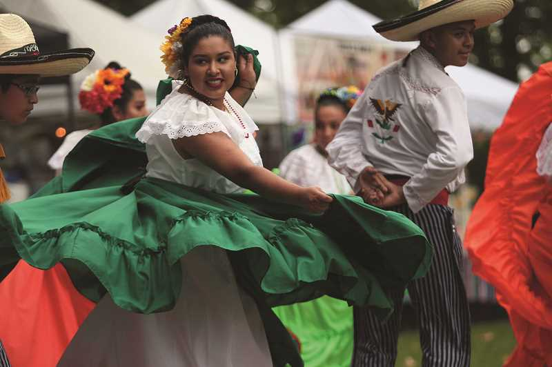 PMG PHOTO: PHIL HAWKINS - Woodburn's 56th Fiesta Mexicana saw thousands of visitors at Legion Park during a three-day period, taking in performances like Cosecha Mestiza (above), along with live music, luchadores, food, soccer carnival games and more.
