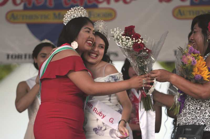 PMG PHOTOS: PHIL HAWKINS - Woodburn's 2019 Fiesta Queen Jessenia Villanueva is crowned and embraced by 2018 Queen Ruby Gonzalez on Friday.