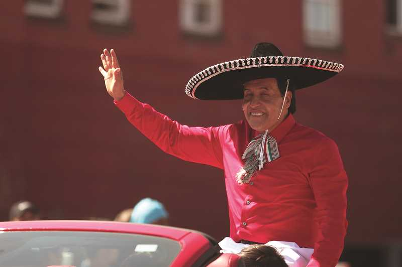 PMG PHOTOS: PHIL HAWKINS - Fiesta carnival rides delighted patrons all weekend, while the annual parade on Saturday saw thousand turn out to see Grand Marshal Elias Villegas (above) lead the long line of floats, cars, dancers and musicians.