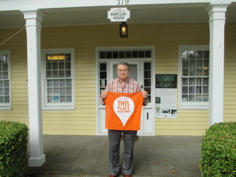 COURTESY PHOTO - Paul Solomon, the former coordinator for the McLoughlin Memorial Association, is pictured on the porch of the Barclay House in Oregon City.