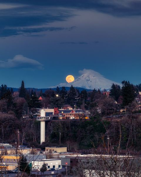 COURTESY PHOTO - George Shubin's photograph catches the moon seeming to peek out over Mount Hood, searching for the Oregon City Municipal Elevator.