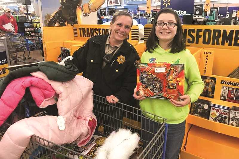 PHOTO SUBMITTED BY PRINEVILLE POLICE DEPARTMENT  - Prineville Police Department and Crook County Sheriff's Office have participated in Deschutes County's Shop with a Cop program for years. They will host a local program for the first time this December.