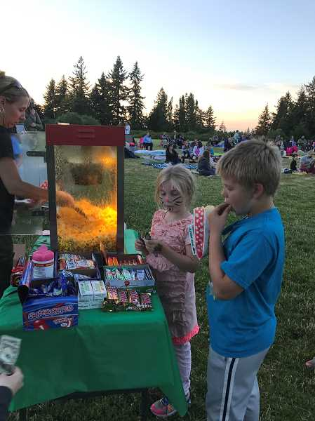 COURTESY PHOTO - The WL Parks and Recreation Department runs a concession stand during the outdoor movie events.