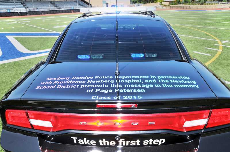 GRAPHIC PHOTO: GARY ALLEN - The rear deck of the Dodge Charger Pursuit police cruiser features a tribute to Page Petersen, an NHS student who took his life in 2015.