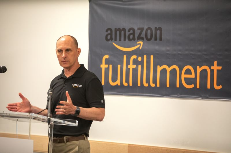 PMG PHOTO: JONATHAN HOUSE  - Mike Moore, general manager of Amazon's robotics fulfillment center in Troutdale, talks about the one year anniversary of the center.