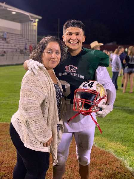 SUBMITTED PHOTO - Victor Torres is with his mother, Erika Montano, after the Shrine game ended.