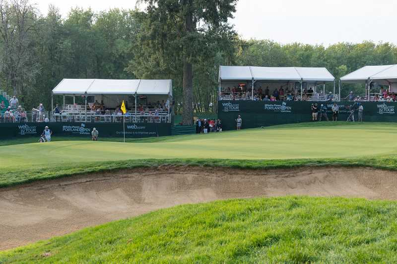 PMG PHOTO: CHRISTOPHER OERTELL - Fans surround the 18th green at Pumpkin Ridge's Witch Hollow Golf Course during last year's Winco Portland Open. The tournament is the last regular season event of the Korn Ferry Tour's year, where the top 25 money winners following the event earn PGA Tour cards.