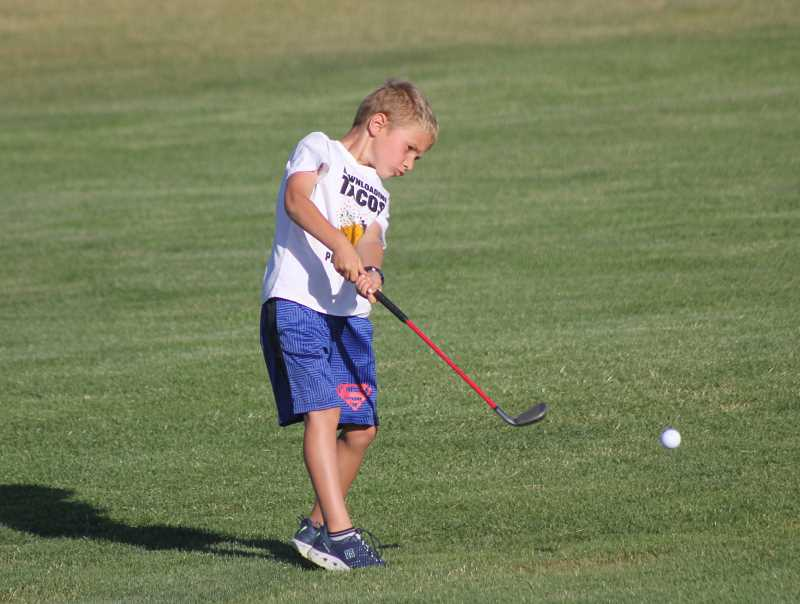 STEELE HAUGEN - Brooks Russell, a Desert Peaks Youth Golf Camp participant, follows through with his swing during the end-of-the-year practice and barbecue July 30.