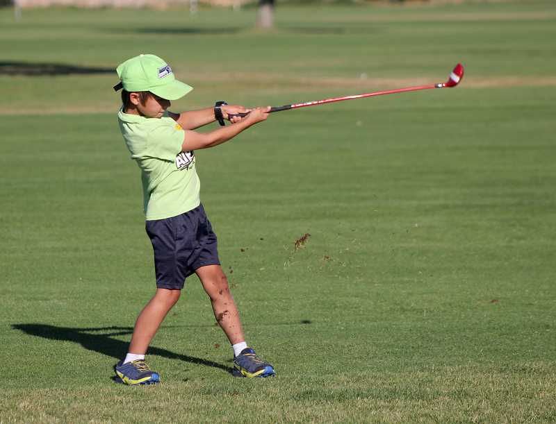 STEELE HAUGEN - Jacob Hurd shows off his golf swing, while hitting a golf ball at the Desert Peaks Golf Camp.