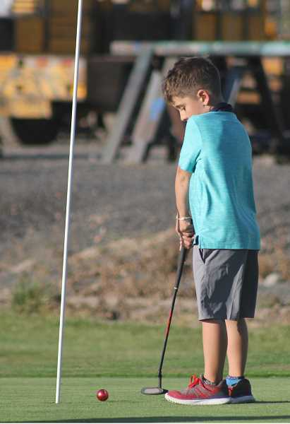 STEELE HAUGEN - Braison Ruiz practices his putting.