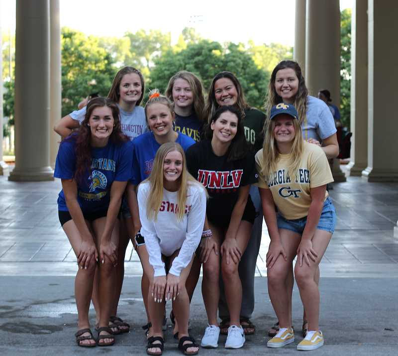 COURTESY PHOTO - Cali Rowland poses for a photo with eight of her former teammates after all were forced to transfer when OSU ended its women's swimming program. Top row (left to right): Erin Harvey, Rachel Pride, Katie Manzione, Conner Doran. Middle row: Rowland, Lauren Yon, Lindsay Swail, Amanda Hoejberg. Front: Felicia Anderson.
