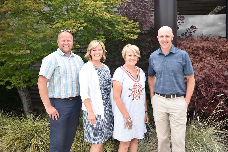 PMG PHOTO: EMILY LINDSTRAND - Scott Crosby, Brooke Wheeler, Brenda Crosby and Matt Day are involved in the leadership of Reliance Connects. Their family has worked for the company for five generations.