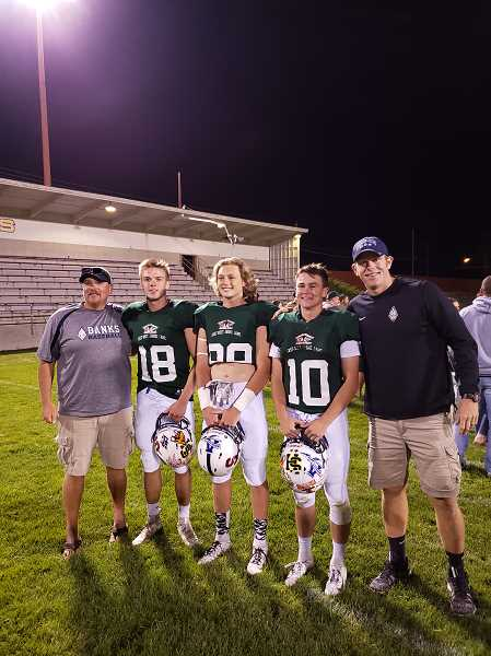 COURTESY PHOTO - Banks coaches and players pose for a picture following the 67th East-West Shrine All-Star Football Game last Saturday, Aug. 3, at Bulldog Memorial Stadium in Baker City. From left to right: Assistant coach Steve Lyda, Blake Markham, Hayden Gobel, Hayden Vandehey and Banks head coach Cole Linehan. The West won the game 43-10.