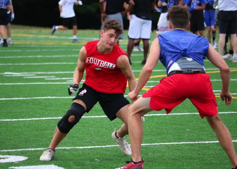 PMG PHOTO: JIM BESEDA - Oregon City's Austin Canchola puts a move on La Salle Prep's Ryan Rosumny during a recent 7-on-7 scrimmage at Lakeridge High School.