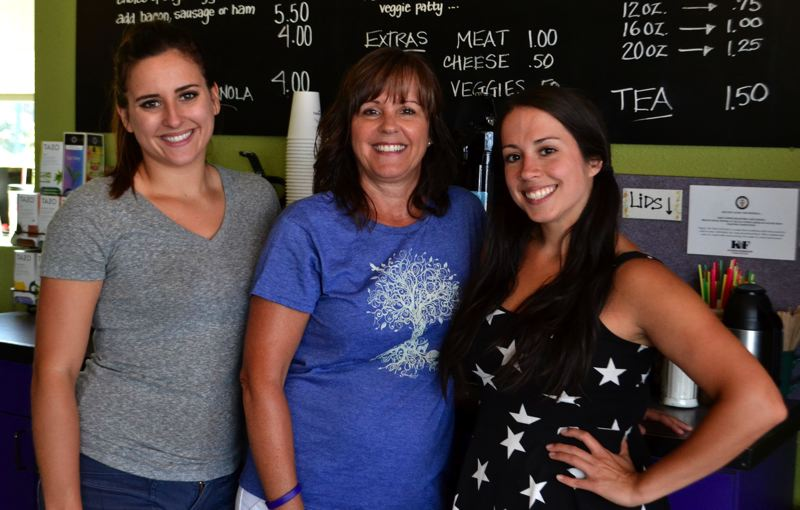PMG FILE PHOTO - Hailey Blaschke, Tina Hovey and Adrienne Acosta serve coffee at Mountain Moka with a smile.