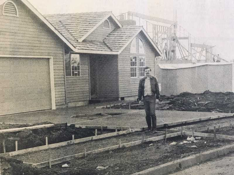 WILSONVILLE SPOKESMAN - Les Balsiger outside his under construction show home on Wimbledon Court in Wilsonville.