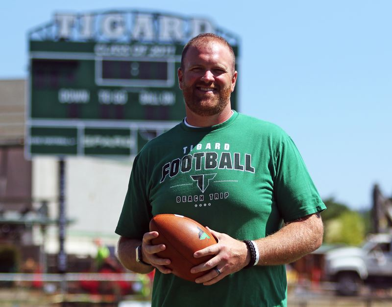 PMG PHOTO: DAN BROOD - John Kemper, who has coached Tigard High School linemen the past 10 years, takes over as the Tigers' head football coach this season.