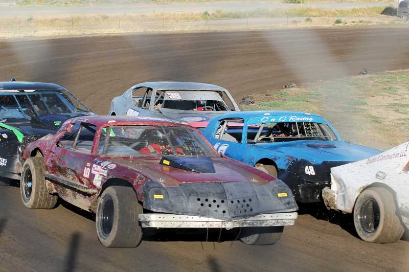 STEELE HAUGEN/MADRAS PIONEER - Sportsman division cars zoom around the track at the Madras Speedway during a weekend race in August.