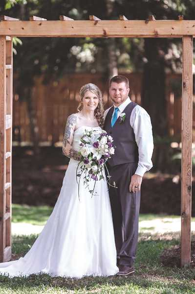 COURTESY PHOTO - Adrienne Schweizer and Bobby Barnes, both of Molalla, married on July 13.