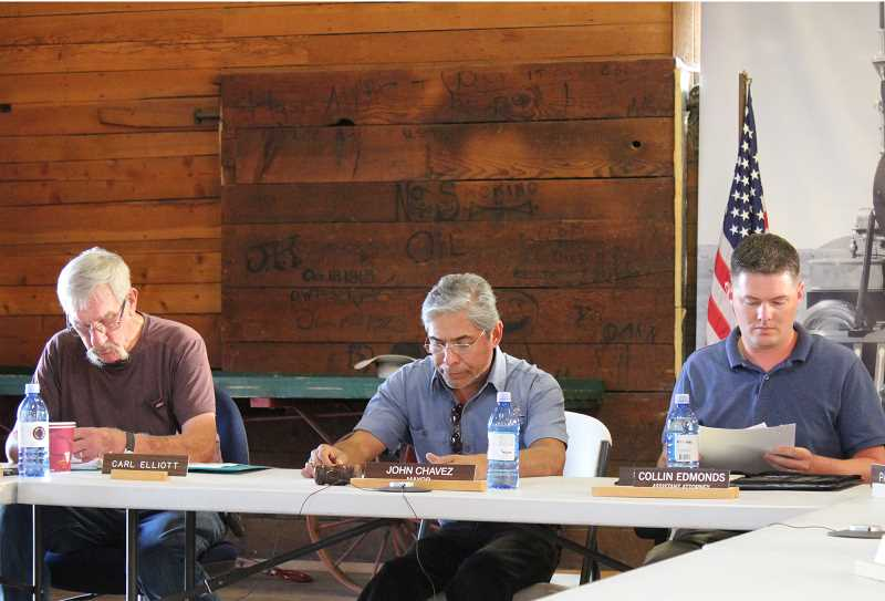 HOLLY M. GILL/MADRAS PIONEER - From left to right, Foncie 'Carl' Elliott, Metolius City Council president, Mayor John Chavez, and assistant attorney Collin Edmonds prepare for the start of the Monday night Metolius City Council meeting.