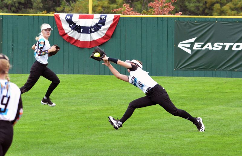 TIMES PHOTO: MATT SINGLEDECKER - Team Oregon centerfielder Lucia Regnier makes a diving catch against Canada in pool play.