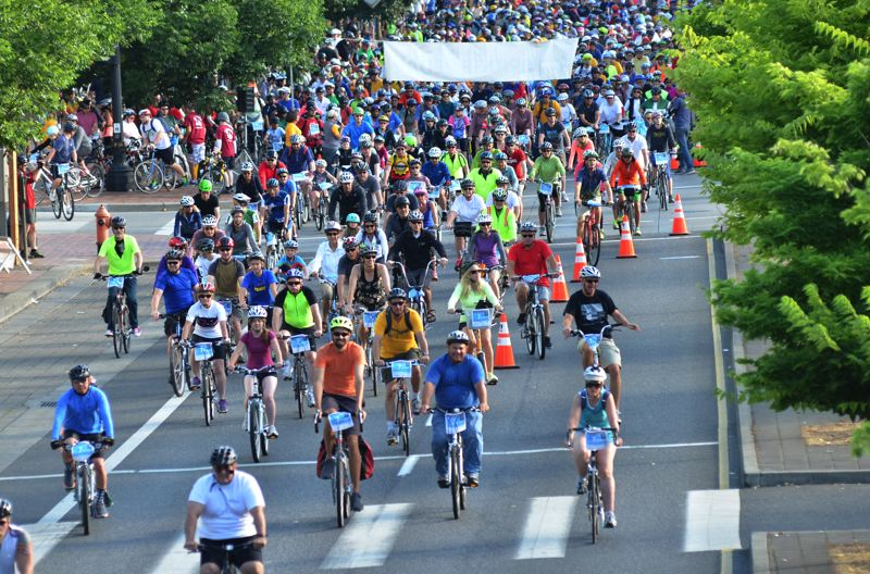 COURTESY PHOTO - Thousands of bicyclists take to the Portland roads and bridges in Providence Bridge Pedal, Sunday, Aug. 11.
