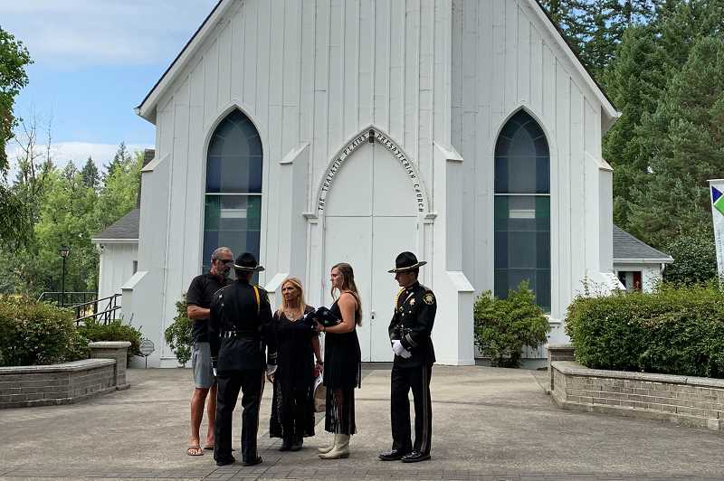 PMG PHOTO: GEOFF PURSINGER - Justin Meek's father, mother and sister talk with Washington County Sheriff's Office detectives after a memorial service on Wednesday, Aug. 7.