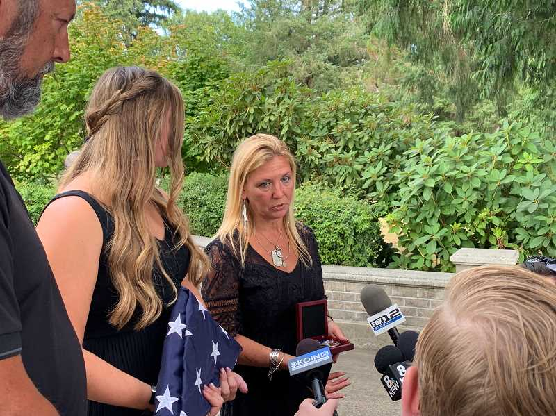 PMG PHOTO: GEOFF PURSINGER - Laura Lynn Meek, right, speaks with reporters after her son Justin Meek's memorial service on Aug. 7. Justin Meek was killed in a mass shooting in November 2018. Generations of the Meek family have been buried on Scotch Church Road dating back to the 1800s.