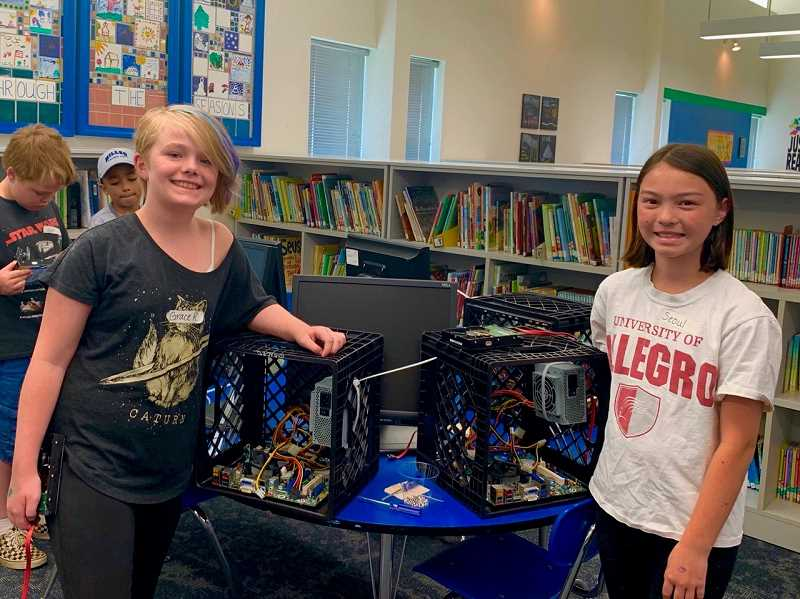 COURTESY PHOTO - Two STEAM program participants show off their hand-built computers.